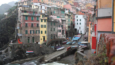 Houses on Cliff in Riomaggiore, fishing village on Mediterranean Sea in Cinque T Footage