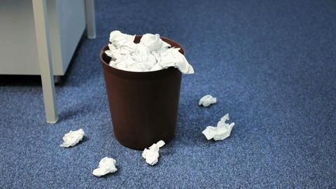 Crumpled Paper in Trash Bin Footage