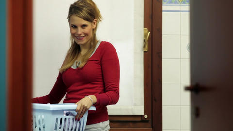 Woman With Clothes IN Basket Footage