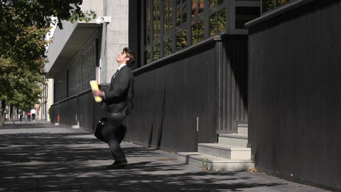 Medium Shot of Happy Businessman Coming Outside From Office Building Footage