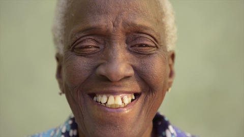 Portrait Of Funny Elderly Black Woman Smiling At C stock footage