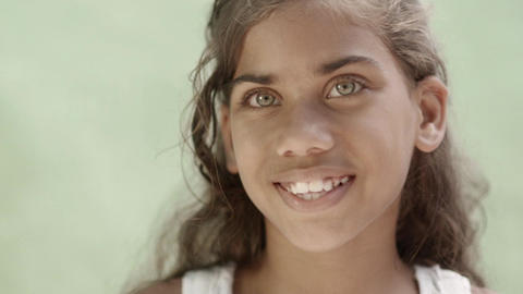 Hispanic little girl with green eyes smiling Footage