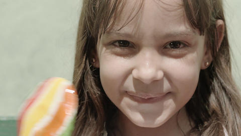 Portrait Of Female Child With Lollipop stock footage