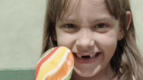 Portrait of female child with lollipop Footage