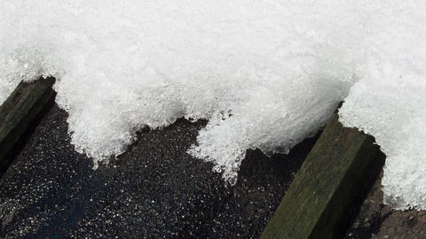 On the roof of the snow melts. Time Lapse Footage