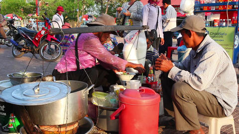 Cambodian woman sells soup Footage