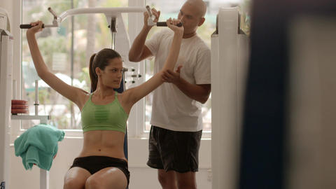 Personal Trainer Helping Woman in Gym Live Action