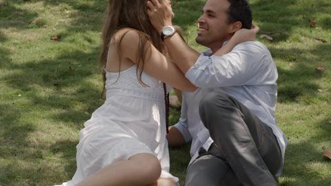 Boyfriend And Girlfriend Laying On Grass Slow Moti stock footage