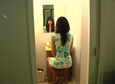 Beautiful Young Woman in Her Bathroom Brushing Her Hair 7 Stock Video Footage