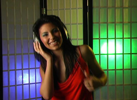 Beautiful Young Woman Listens to Music in Her Headphones 16 Stock Video Footage