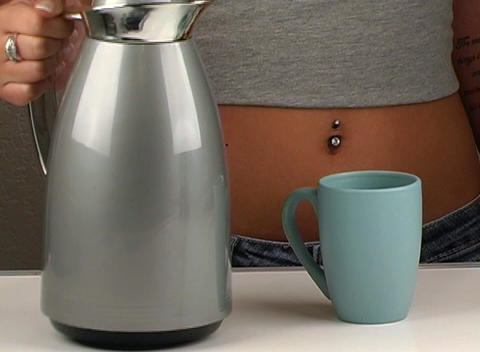 Woman Wearing Jeans Pours Coffee Stock Video Footage