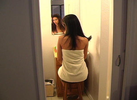 Beautiful Young Woman in Her Bathroom Brushing Her Hair 6 Stock Video Footage