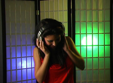 Beautiful Young Woman Listens to Music in Her Headphones 15 Stock Video Footage