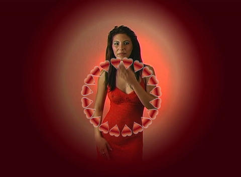 Beautiful Young Woman in Red Blows a Kiss with a Ring of... Stock Video Footage