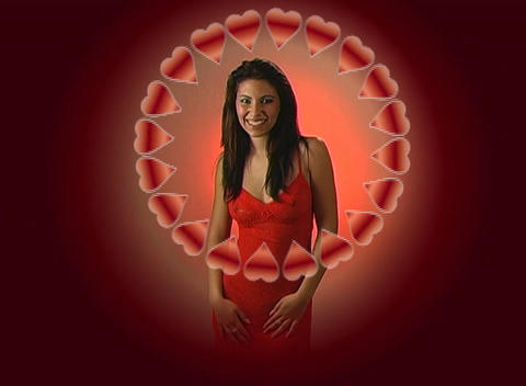 Beautiful Young Woman in Red Blows a Kiss with a Ring of Hearts 2 Footage
