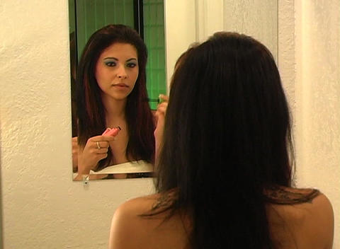 Beautiful Young Woman Applies Mascara 1 Stock Video Footage