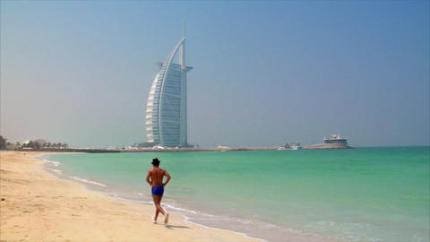 jogging at dubai beach Stock Video Footage