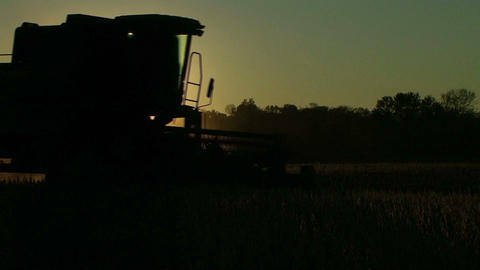 Combine Silhouette At Sunset Stock Video Footage