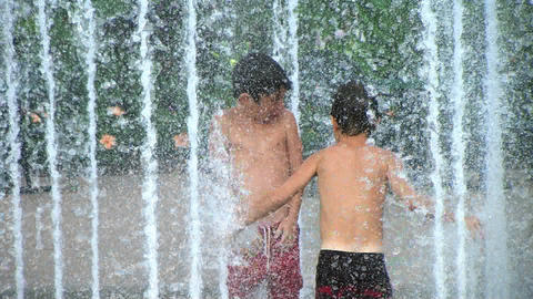 Kids Playing in Fountain Stock Video Footage