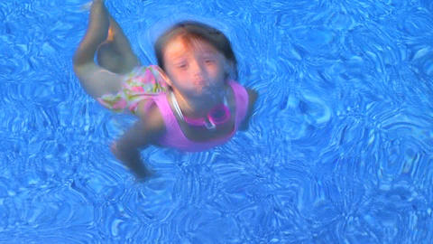 Girl Swimming and Smiling Stock Video Footage