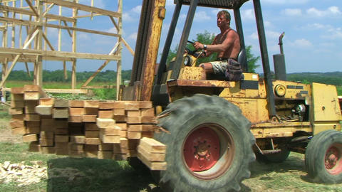 Forklift Unloading Construction Lumber Stock Video Footage