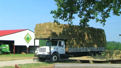 Truck Hauling Hay Bales Stock Video Footage