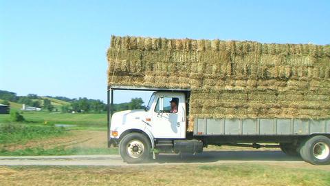 Truck Hauling Hay Bales Stock Video Footage