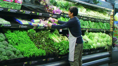Man Facing Vegetables In Produce Footage