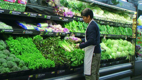 Man Facing Vegetables In Produce Stock Video Footage
