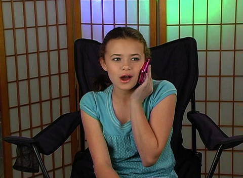 Beautiful Adolescent Girl Talks on Her Cell Phone Stock Video Footage