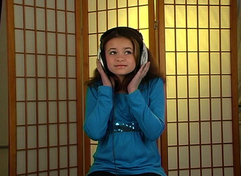 Beautiful Adolescent Girl Listens to Music with He Stock Video Footage