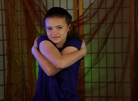Beautiful Adolescent Girl Hugs Herself Stock Video Footage