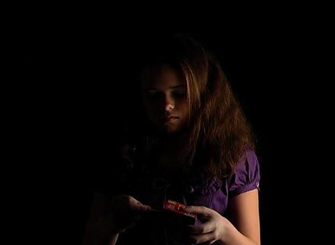 Beautiful Adolescent Girl Lights a Match (2) Stock Video Footage