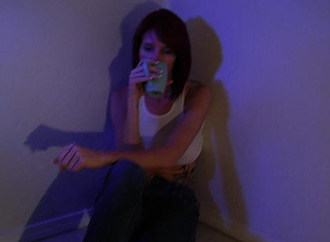 Beautiful Redhead Sitting in a Corner Drinking Cof Footage