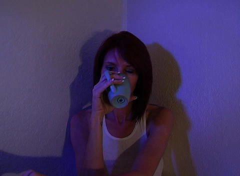 Beautiful Redhead Sitting in a Corner Drinking Cof Stock Video Footage