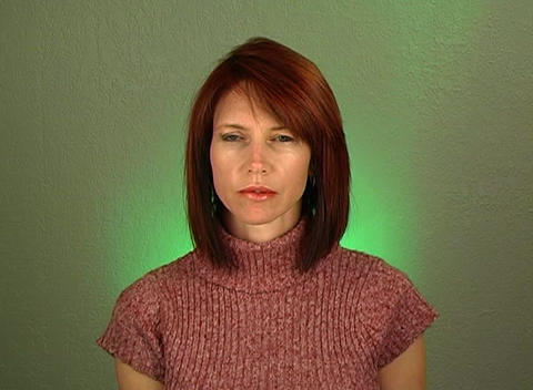 Beautiful Redhead with a Serious Facial Expression Live Action