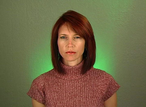Beautiful Redhead with a Serious Facial Expression Stock Video Footage