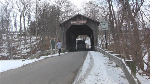 Covered Bridge with Vehicle and Woman Jogging Footage