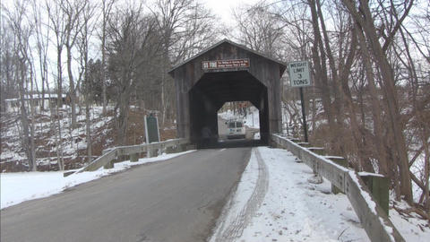 Covered Bridge with Vehicle and Woman Jogging Stock Video Footage