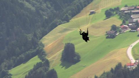 paraglider over austrian village Footage