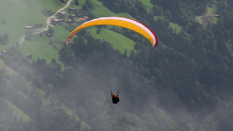 paraglider out of clouds Stock Video Footage