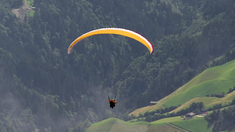 paraglider out of clouds Footage