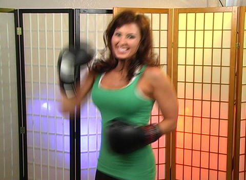 Beautiful Brunette with Boxing Gloves (2) Stock Video Footage