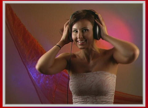 Beautiful Brunettee Dances with Headphones (2) Footage
