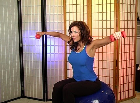 Beautiful Brunette Working Out with Hand Weights ( Footage