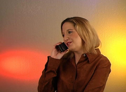 Beautiful Blonde Talking on a Cell Phone (1) Stock Video Footage