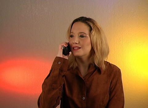 Beautiful Blonde Talking on a Cell Phone (3) Stock Video Footage