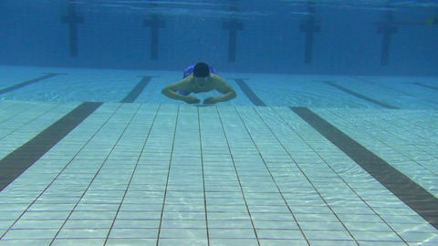 young man swimming in the swimming pool Footage