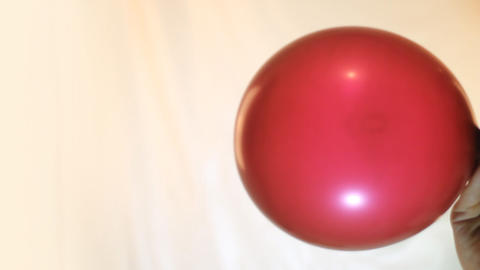 balloon is inflated and blown off by close up Footage