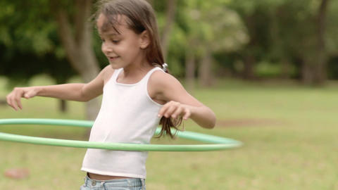 Little Girl Playing Hula Hoop Slow Motion Footage